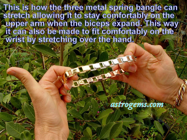 three metal spring bangle expanded
