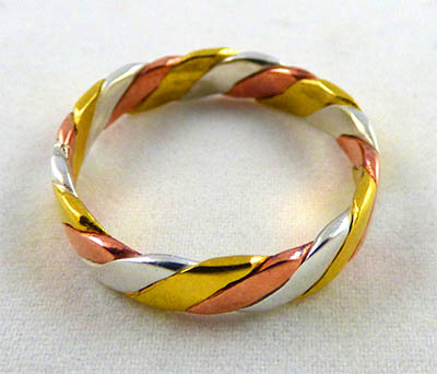 Another one of our tri-metal rings, the Flattened Rope Twist.