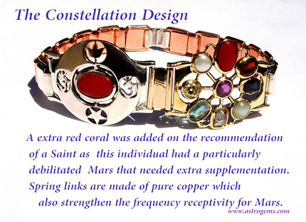 constellation design bangle with added red coral