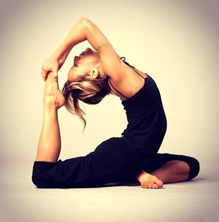 woman in black doing yoga wearing bangle