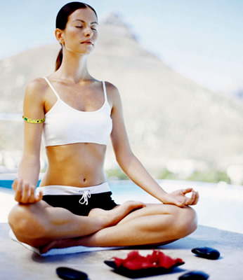 woman in meditation wearing gem bangle