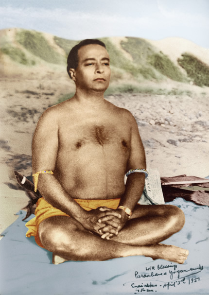 yogananda on beach meditating